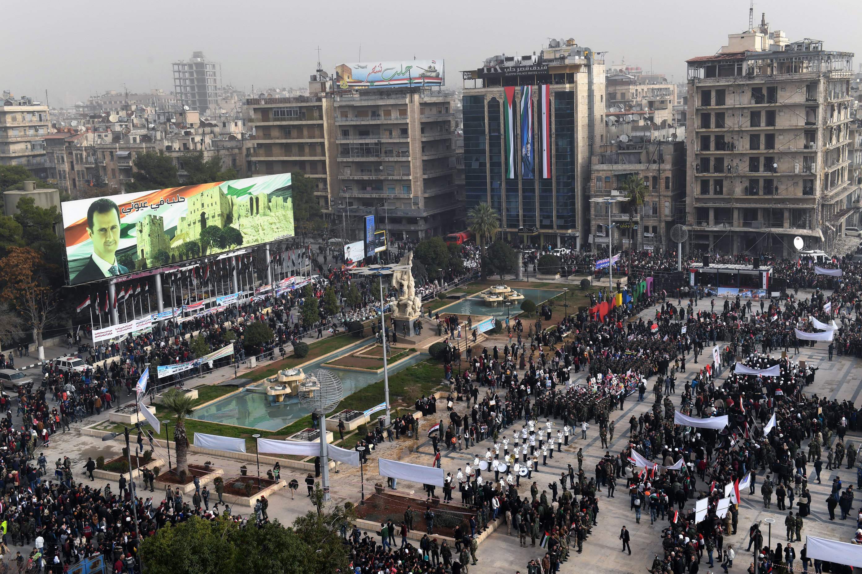 A picture taken on December 21, 2017 shows an elevated view of the square of Saadallah al-Jabiri as marching bands, soldiers, and civilians gather in a government celebration marking the first anniversary of the retaking of the second Syrian city of Aleppo