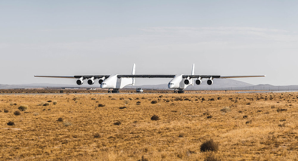 The Stratolaunch aircraft taxis on a runway in California.