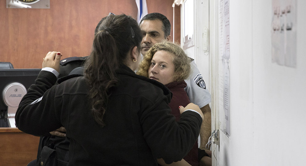 ISRAEL OUT - Palestinian Ahed Tamimi Is escorted at a military court near Jerusalem, Wednesday, Dec. 20, 2017