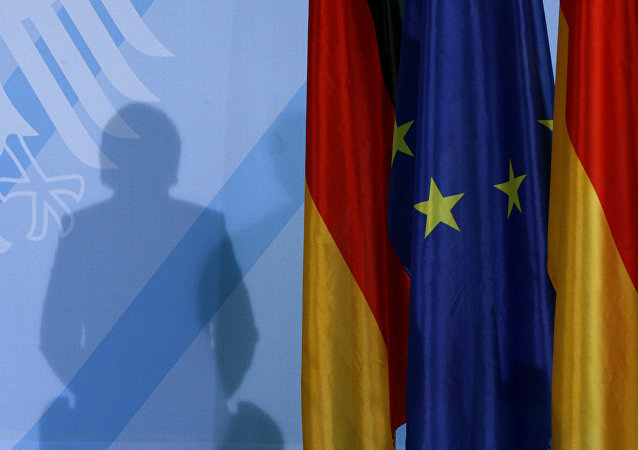 The shadow of German Chancellor Angela Merkel photographed as she addresses the media after a meeting with German parliament floor leaders about the European Union bail-out in Berlin, Monday, May 10, 2010.