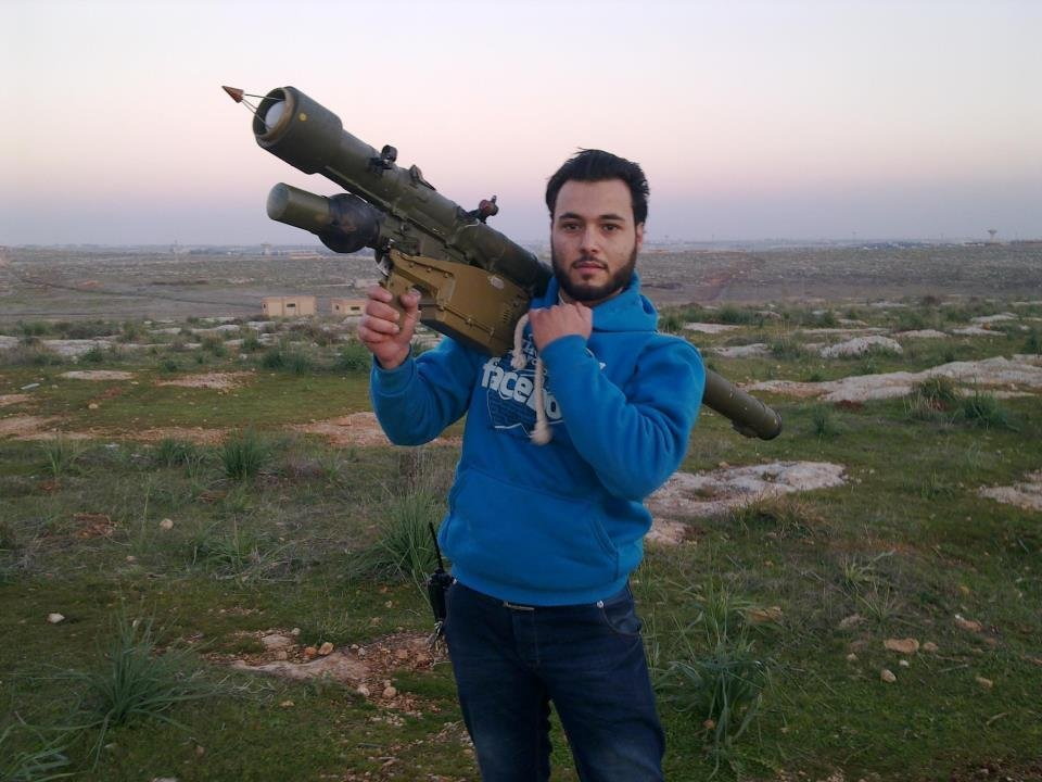 Iessa Obied, a medical professional connected with Hand in Hand for Syria, poses with rocket launcher.