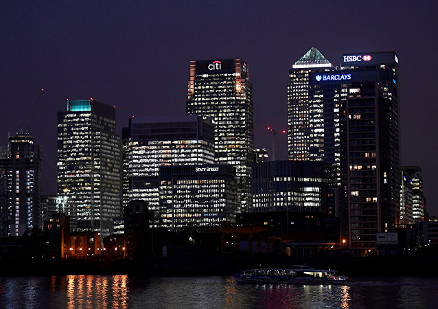 Office blocks of Citi, Barclays, and HSBC banks are seen at dusk in the Canary Wharf financial district in London, Britain November 16, 2017