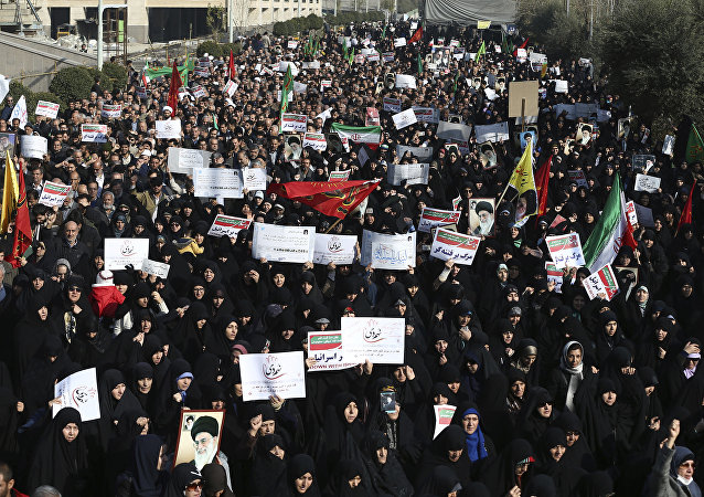 Iranian protesters chant slogans at a rally in Tehran, Iran, Saturday, Dec. 30, 2017