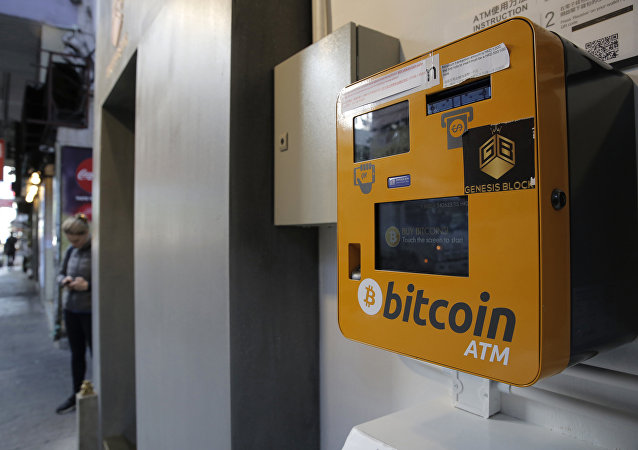 A Bitcoin ATM is placed in a public area in Hong Kong, Thursday, Dec. 21, 2017. Bitcoin is the world's most popular virtual currency. Such currencies are not tied to a bank or government and allow users to spend money anonymously. They are basically lines of computer code that are digitally signed each time they are traded.