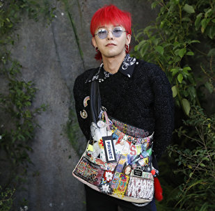 Kwon Ji-yong aka G-Dragon poses during a photocall prior to the Chanel women's 2018 Spring/Summer ready-to-wear collection fashion show in Paris, on October 3, 2017