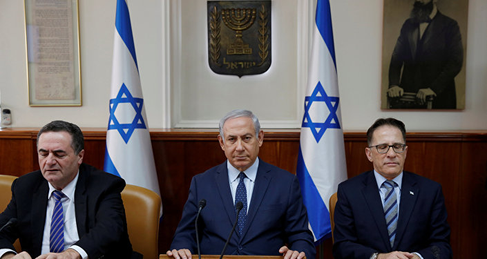 Israeli Prime Minister Benjamin Netanyahu (C) sits next to Cabinet Secretary Tzachi Braverman (R) and Israeli Intelligence and Transportation Minister Israel Katz (L) at the start of the weekly cabinet meeting at the Prime Minister's office in Jerusalem January 7, 2018