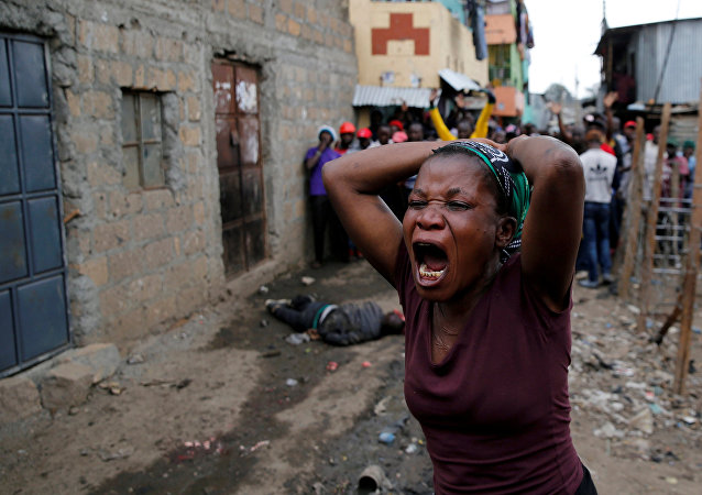A woman gestures as she mourns the death of a protester in Mathare, in Nairobi, Kenya, August 9, 2017