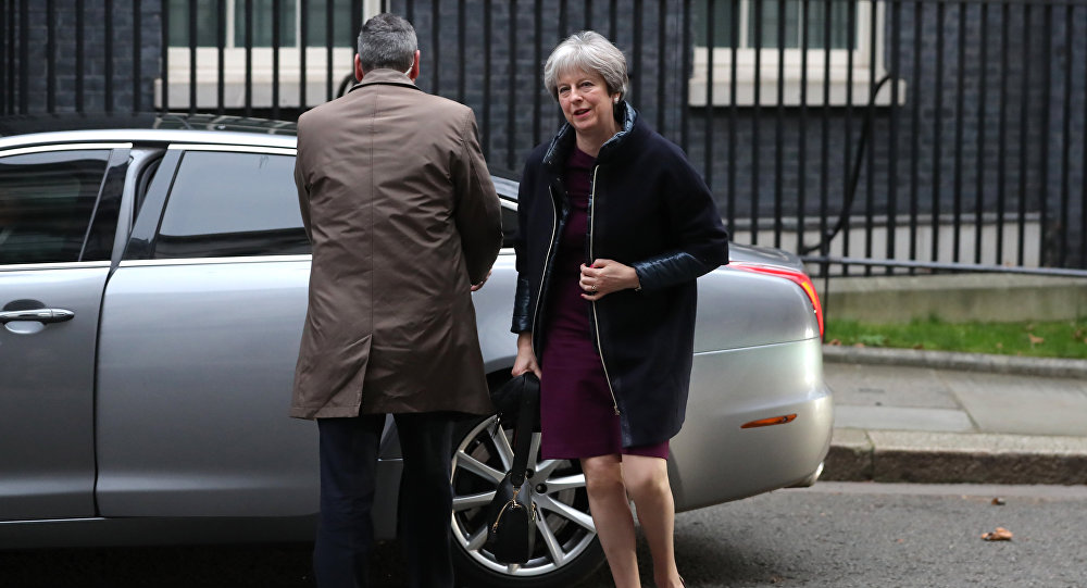 British Prime Minister Theresa May arrives at 10 Downing street in London on January 8, 2018