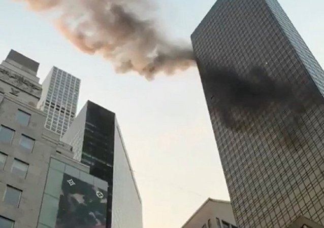 A smoke is seen rising from the roof of Trump Tower, in New York, U.S., January 8, 2018 in this still image obtained from social media video