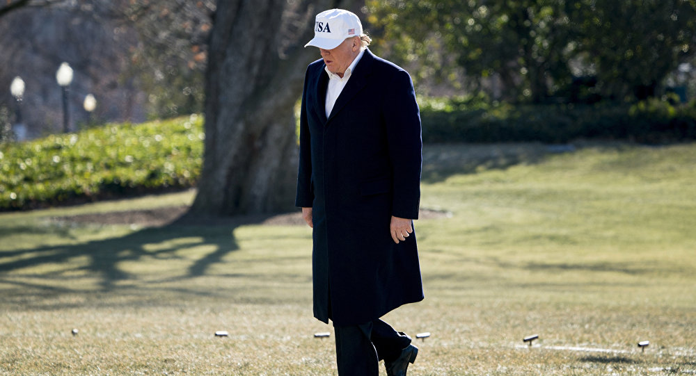 President Donald Trump walks across the South Lawn as he arrives at the White House in Washington Sunday Jan. 7 2018 after traveling from Camp David Md