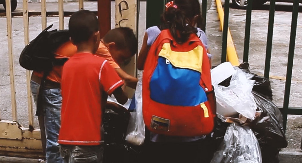 Children rummage in garbage on streets of Venezuela