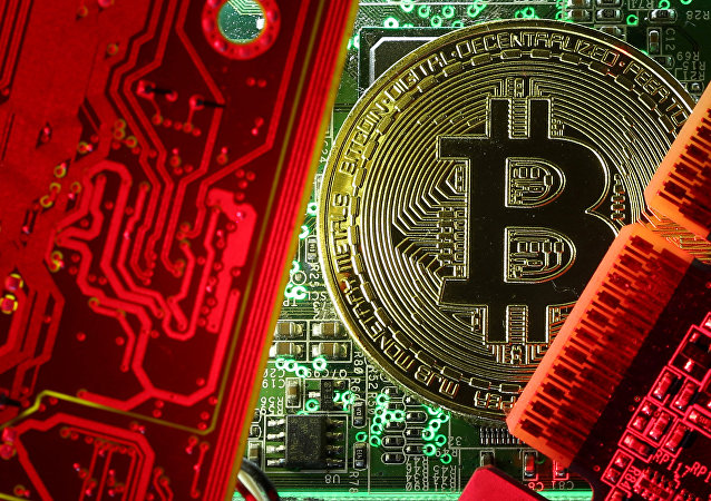A coin representing the bitcoin cryptocurrency is seen on computer circuit boards in this illustration picture, October 26, 2017