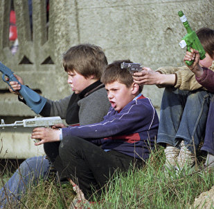 Children playing war. File photo