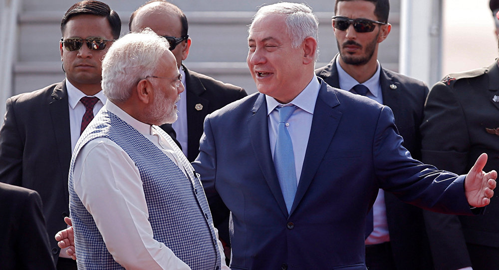 Israeli Prime Minister Benjamin Netanyahu is welcomed by his Indian counterpart Narendra Modi upon his arrival at Air Force Station Palam in New Delhi, India, January 14, 2018