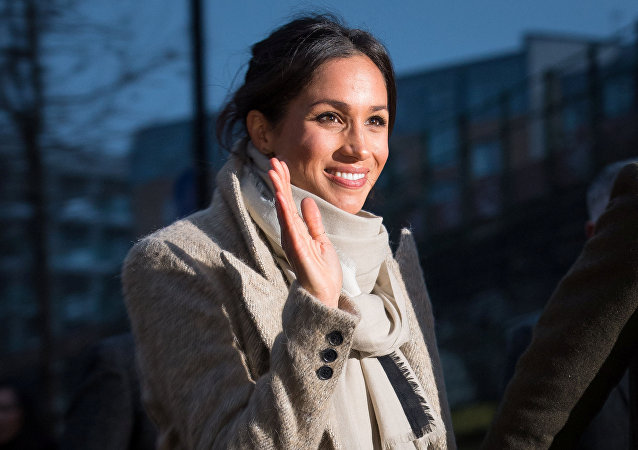 Meghan Markle waves to well wishers after visiting radio station Reprezent FM, with her fiancee Britain's Prince Harry, in Brixton, London January 9, 2018
