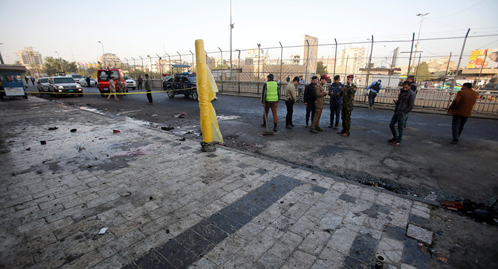 Iraqi security forces inspect the site of a bomb attack in Baghdad, Iraq January 15, 2018
