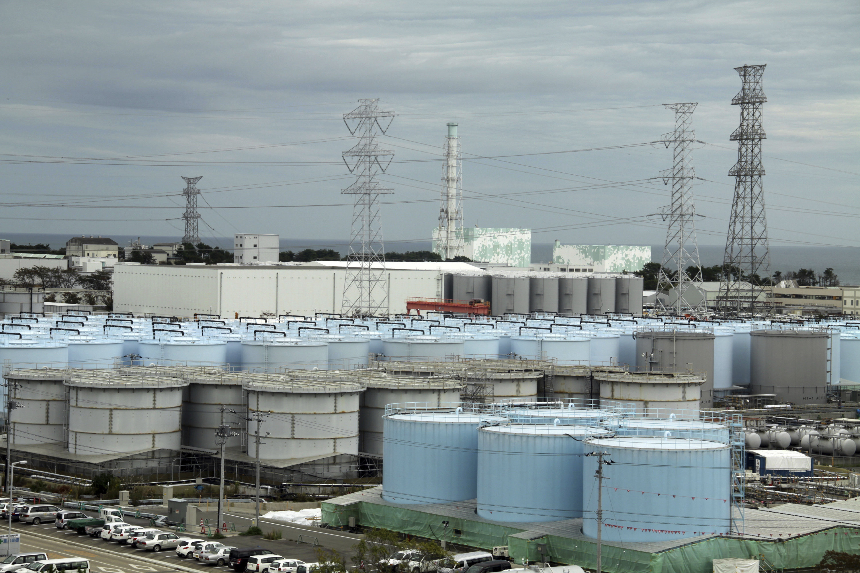 In this Oct. 12, 2017, photo, ever-growing amount of contaminated, treated but still slightly radioactive, water at the wrecked Fukushima Dai-ichi nuclear plant is stored in about 900 huge tanks, including those seen in this photo taken during a plant tour at Fukushima Daiichi Nuclear Power Plant in Okuma, Fukushima Prefecture, northeast of Tokyo