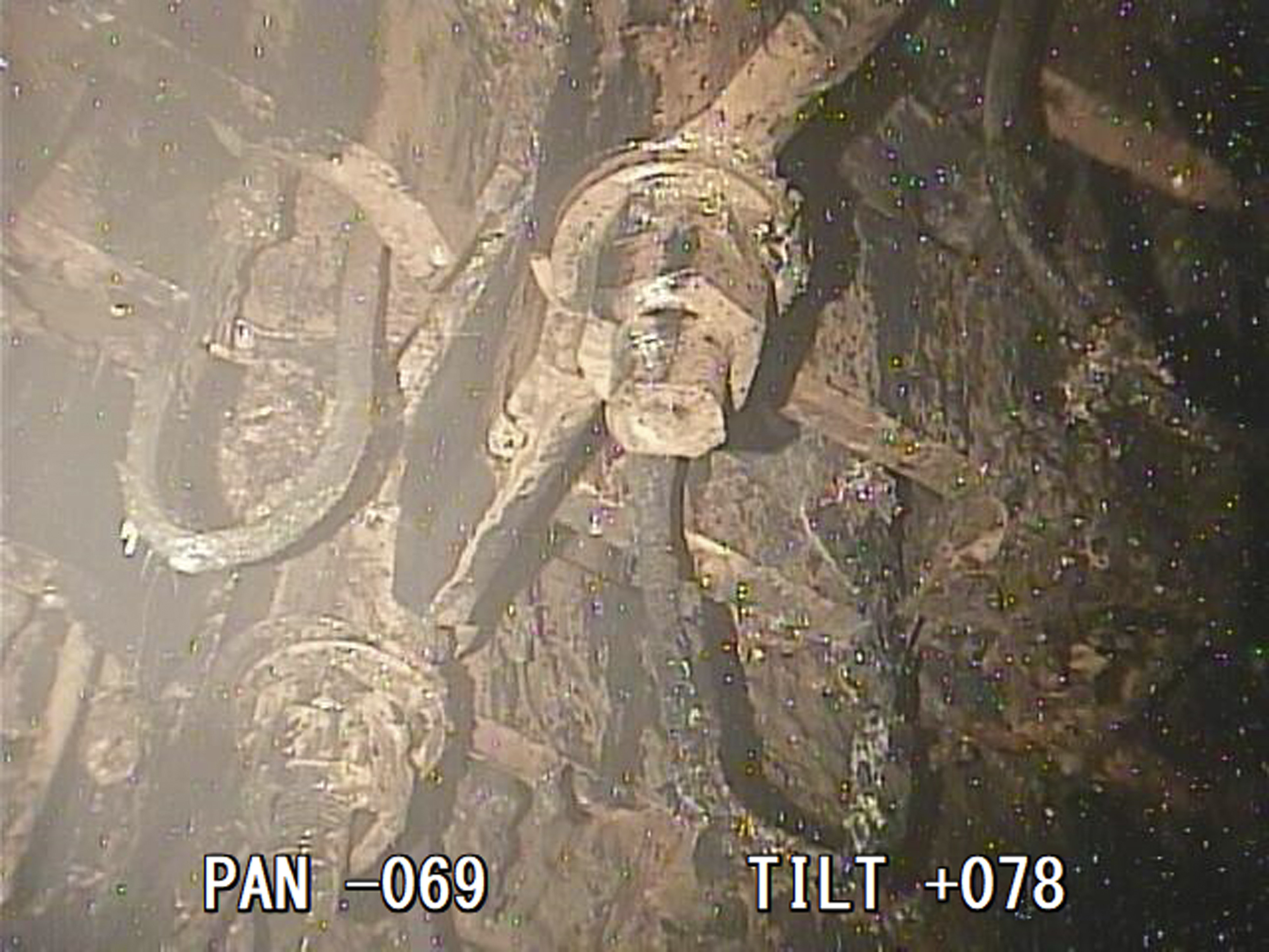 A photo taken by a robotic probe provided by the International Research Institute for Nuclear Decommissioning, Friday, Jan. 19, 2018, shows a view of the bottom of a structure housing a safety system called the control rod drive, which appeared rusty and coated with unidentified material at the Fukushima nuclear plant