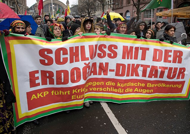 Members of the Kurdish community in Germany hold a banner asking to put an end to Erdogan's dictatorship during a demonstration on January 18, 2018 in Frankfurt am Main to protest after Turkey launched a new air and ground operation to oust Kurdish militia from a northern Syrian enclave, defying US warnings that the action risked destabilising the area