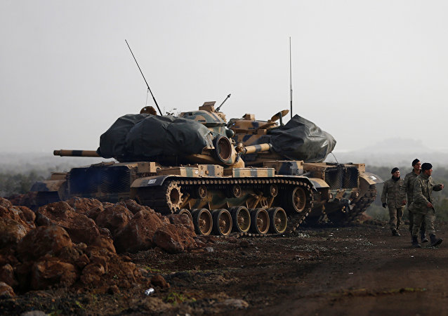 Turkish soldiers and tanks are pictured in a village on the Turkish-Syrian border in Gaziantep province, Turkey January 22, 2018
