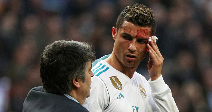 Soccer Football - La Liga Santander - Real Madrid vs Deportivo La Coruna - Santiago Bernabeu, Madrid, Spain - January 21, 2018 Real Madrid's Cristiano Ronaldo receives treatment after sustaining an injury whilst scoring their sixth goal