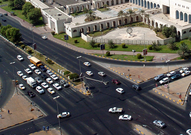 Cars drive on a busy highway intersection in downtown Abu Dhabi. File photo