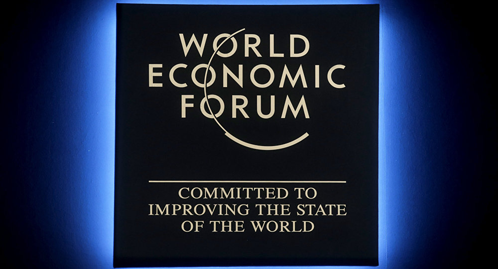 A Forum's logo shines during the annual meeting of the World Economic Forum in Davos, Switzerland, Tuesday, Jan. 23, 2018