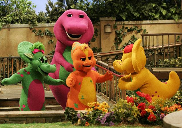 Riff, front, center, a new character on the Barney & Friends show, is shown with with the show's other dinosaur characters, Baby Bop, left, Barney, back, and B.J., right, during the taping of a new Barney episode at the Barney & Friends studio in Carrollton, Texas, Tuesday, Aug. 29, 2006