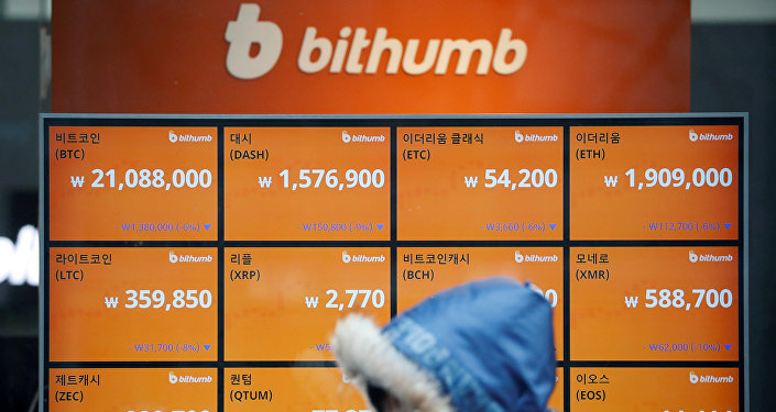 A man walks past an electric board showing exchange rates of various cryptocurrencies at Bithumb cryptocurrencies exchange in Seoul, South Korea, January 11, 2018