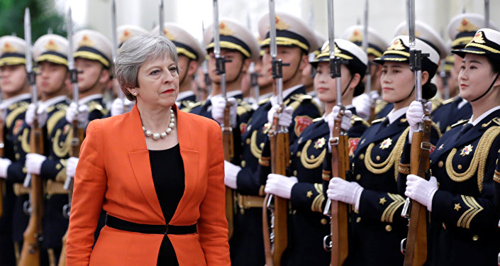British Prime Minister Theresa May reviews honour guards during a welcoming ceremony at the Great Hall of the People in Beijing, China January 31, 2018