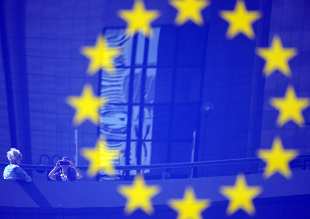 Tourists reflected in a EU logo. File photo