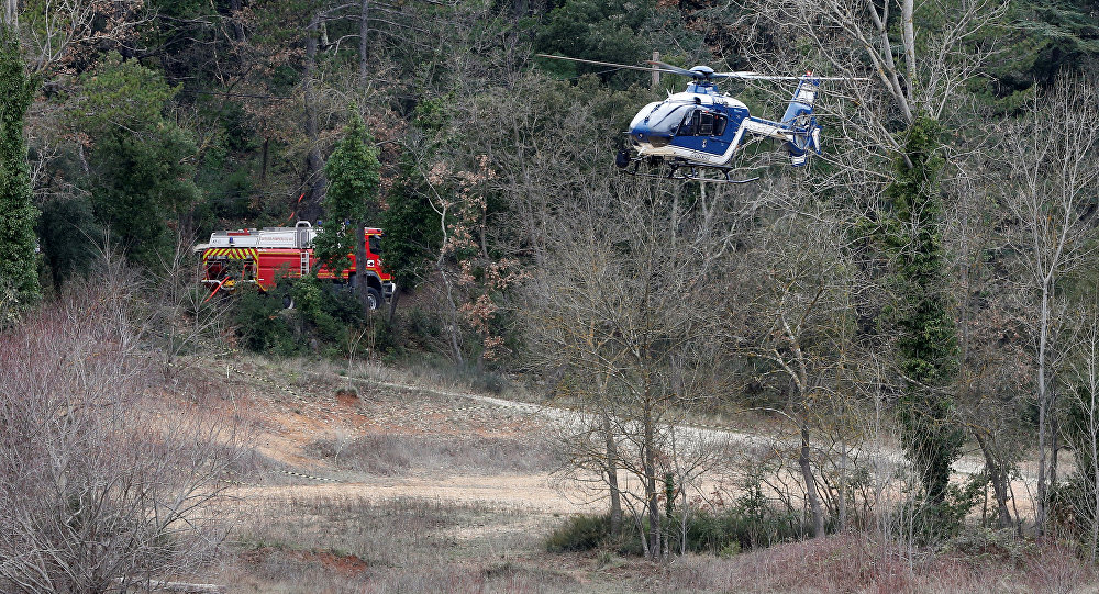 A helicopter from the French gendarmerie prepares to land near the site where two French military helicopters belonging to an army flight training school crashed killing five people near the Lac de Carces in the southeastern Var region, France, February 2, 2018
