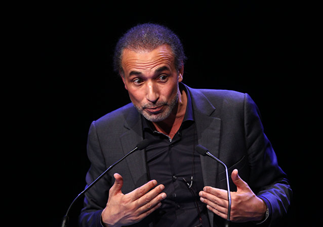 Muslim scholar Tariq Ramadan delivers a speech during a French Muslim organizations meeting in Lille, northern France, Sunday Feb.7, 2016