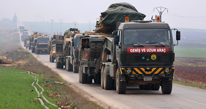 A Turkish military convoy passes through Kafr Halab in the south of Aleppo province on February 5, 2018