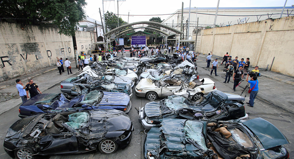 A bulldozer destroys condemned smuggled luxury cars worth 61,626,000.00 pesos (approximately US$1.2 million), which include used Lexus, BMW, Mercedes-Benz, Audi, Jaguar and Corvette Stingray, during the 116th Bureau of Customs founding anniversary in Metro Manila, Philippines February 6, 2018