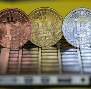 A picture taken on February 6, 2018 shows a visual representation of the digital crypto-currency Bitcoin, at the Bitcoin Change shop in the Israeli city of Tel Aviv
