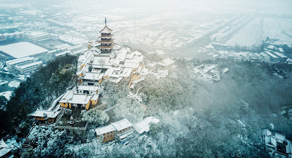 An aerial view of Langshan Mountain after snowfall in Nantong in China's eastern Jiangsu province on January 25, 2018