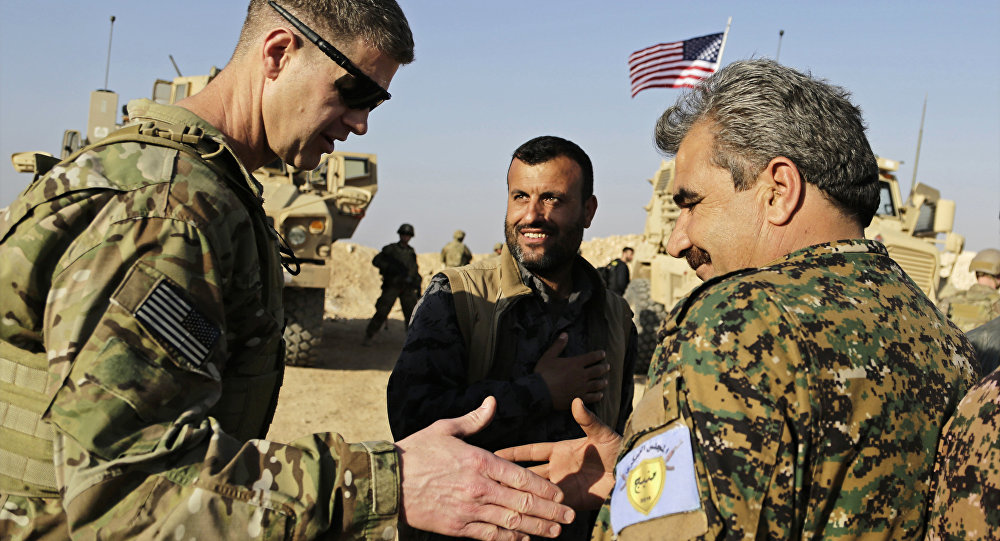 U.S. Army Maj. Gen. Jamie Jarrard left, thanks Manbij Military Council commander Muhammed Abu Adeel during a visit to a small outpost near the town of Manbij, northern Syria, Wednesday, Feb. 7, 2018