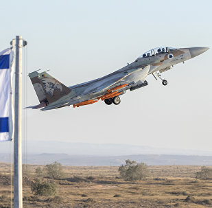 An Israeli Air Force F-15 Eagle fighter plane performs at an air show during the graduation of new cadet pilots at Hatzerim base in the Negev desert, near the southern Israeli city of Beer Sheva, on June 29, 2017