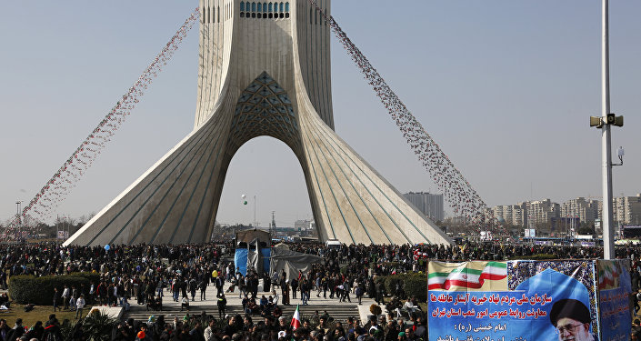 Iranians take part in a rally marking the anniversary of the 1979 Islamic revolution, on February 11, 2018 in the capital Tehran