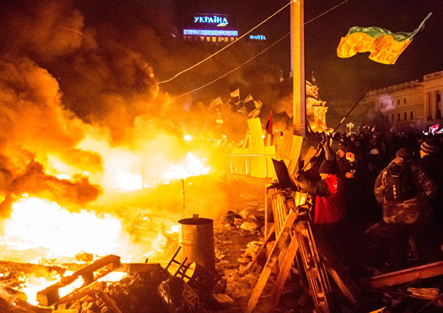 Opposition supporters on Maidan Square in Kiev where clashes between protesters and police began. (File)