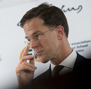 Dutch Prime Mark Rutte adjusts his glasses during a press conference at the Erasmus University in Rotterdam, Netherlands, Monday, March 13, 2017