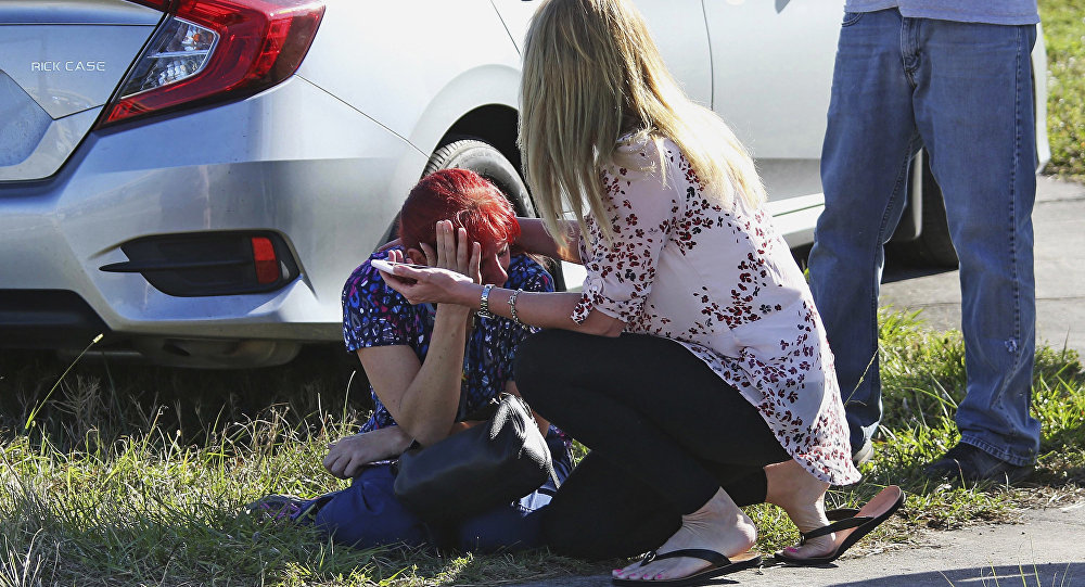 A woman consoles another as parents wait for news regarding a shooting at Marjory Stoneman Douglas High School in Parkland, Fla., Wednesday, Feb. 14, 2018.