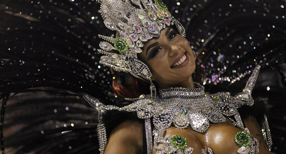 Drum queen Milena Nogueira from Imperio Serrano samba school performs during the first night of the Carnival parade at the Sambadrome in Rio de Janeiro, Brazil February 11, 2018