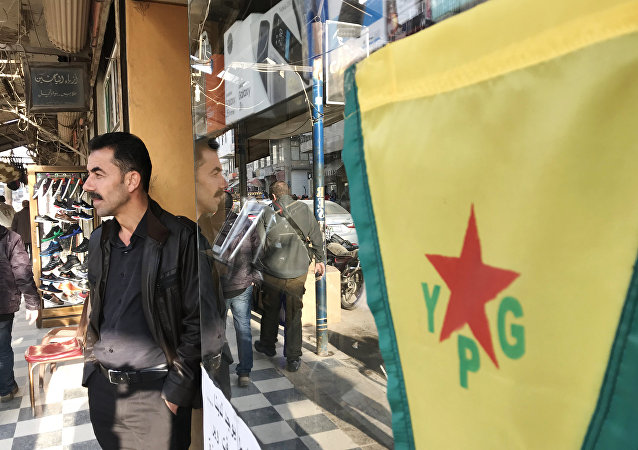 Flag of the Kurdish YPG self-defense forces on the central street of the city of Afrin, Syria. File photo