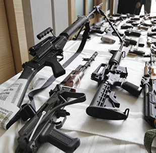 In this July 22, 2010, file photo, various guns are displayed at the Chicago FBI office