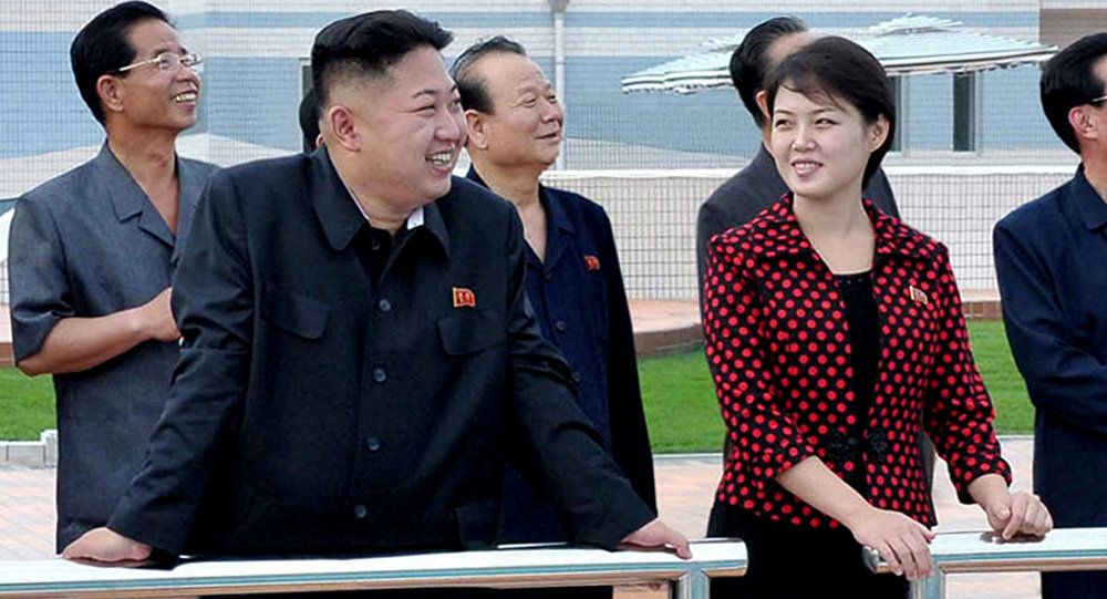 North Korean leader Kim Jong Un front left accompanied by his wife Ri Sol Ju front right inspects the Rungna People's Pleasure Ground in Pyongyang