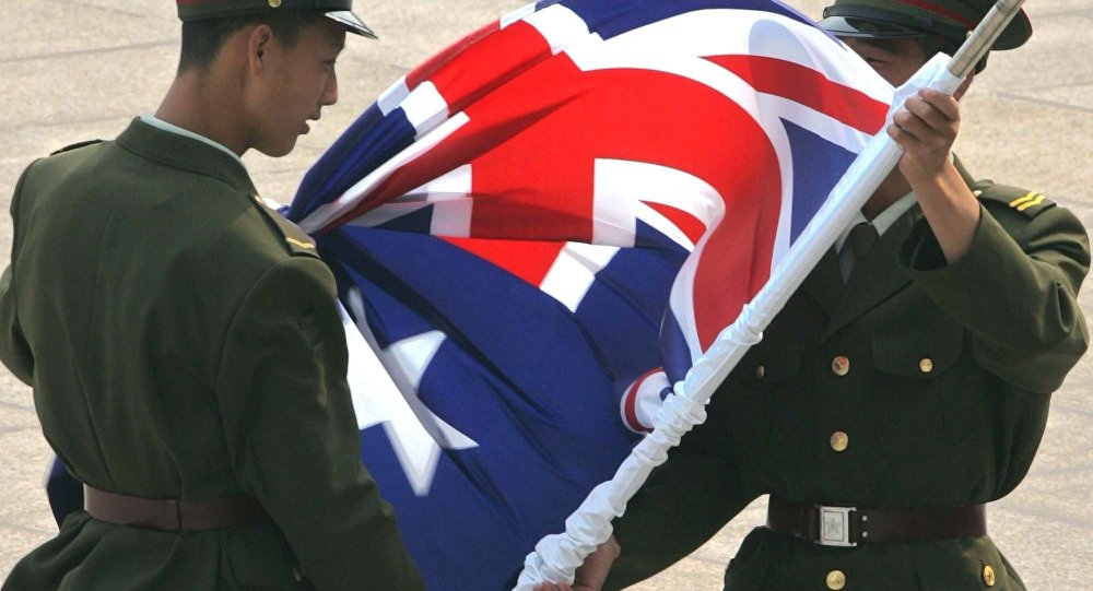 Chinese soldiers unfurl the Australian flag. (File)