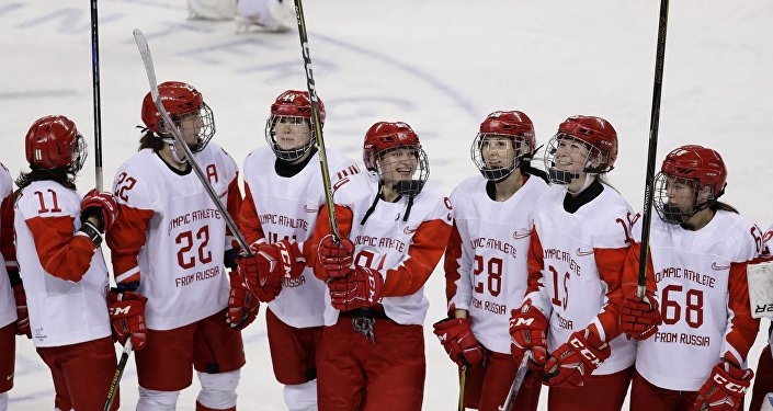 Ice Hockey - Pyeongchang 2018 Winter Olympics - Women's Quarterfinal Match - Olympic Athletes from Russia v SWI - Kwandong Hockey Centre, Gangneung, South Korea - February 17, 2018 - Olympic Athletes from Russia celebrate after defeating Switzerland
