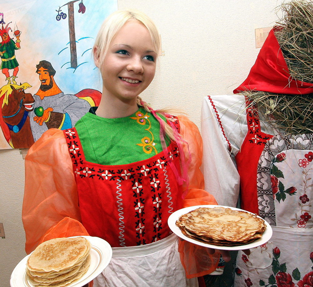 Pancake week in Vladivostok's professional vocational school N43. Its student is demonstrating old fashioned Russian pancakes.